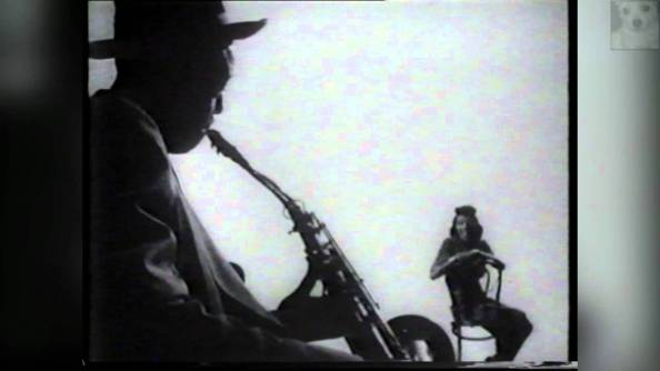 Lester with saxophone and Pork Pie hat